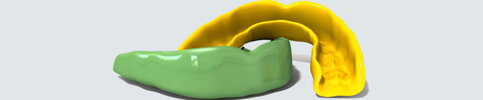 Two regular yellow and green moulded sports gum guards - Paxton, MA
